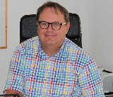 Das Bild zeigt den Rechtsanwalt Burkhard Müller