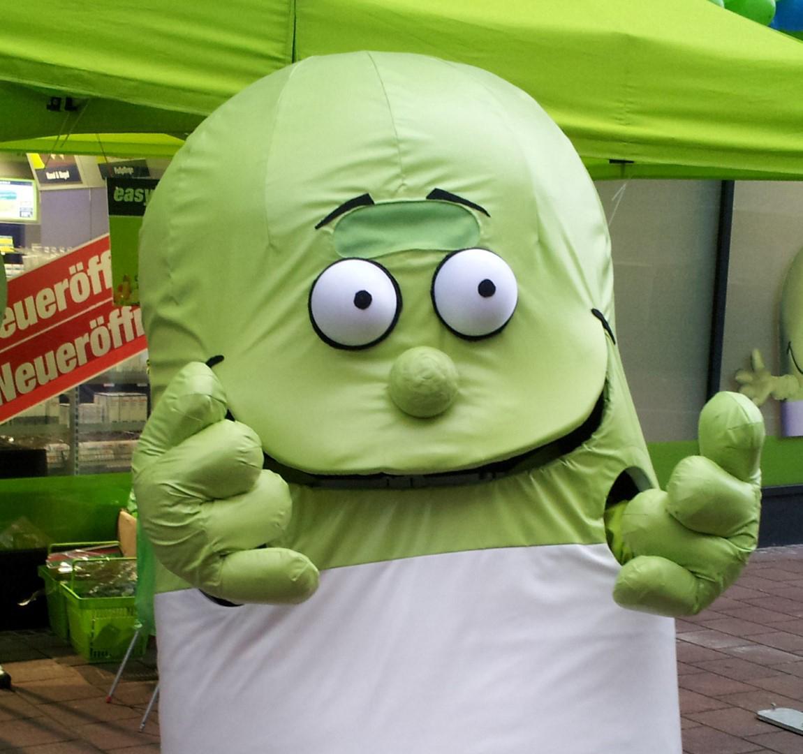 Das Bild zeigt ein grünes Maskotchen der easyApotheke Siegburg City