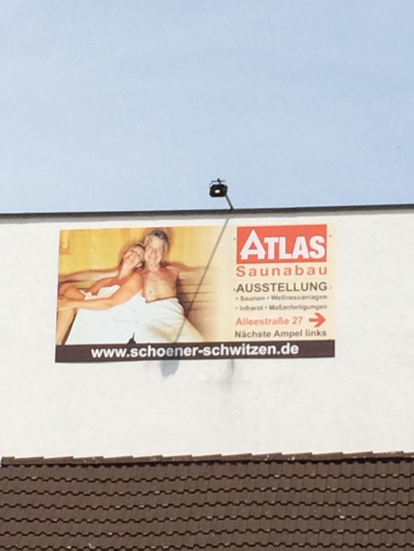 Das Bild zeigt ein Plakat der Atlas Saunabau GmbH